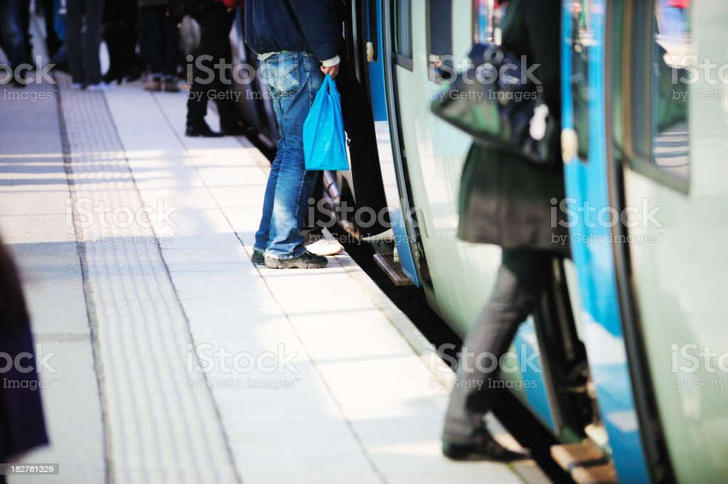 Train passengers entering commuter carriage royalty-free stock photo