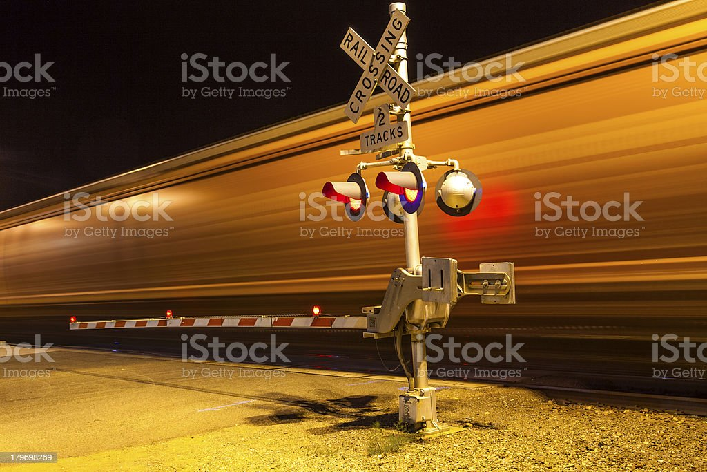 train passes a crailway crossing by night at route 66 stock photo