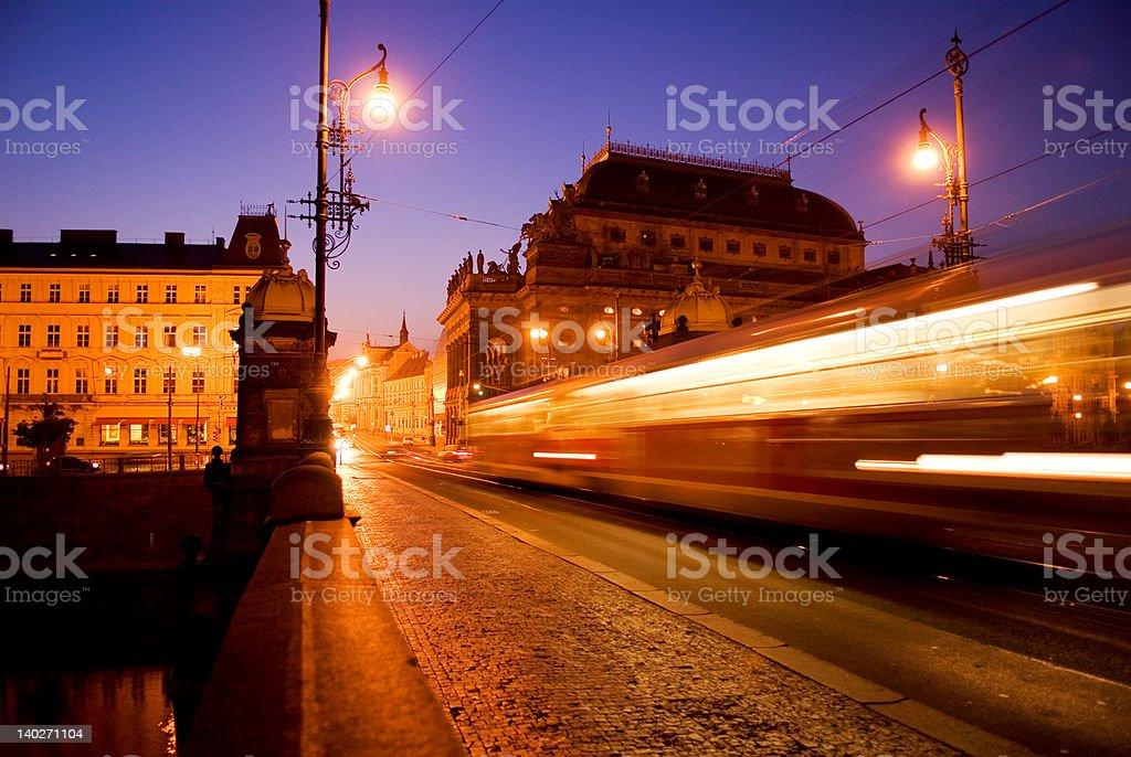 Train passes over Prague bridge stock photo