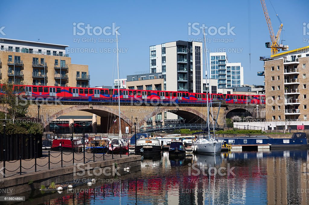 DLR Train passes over the viaduct stock photo