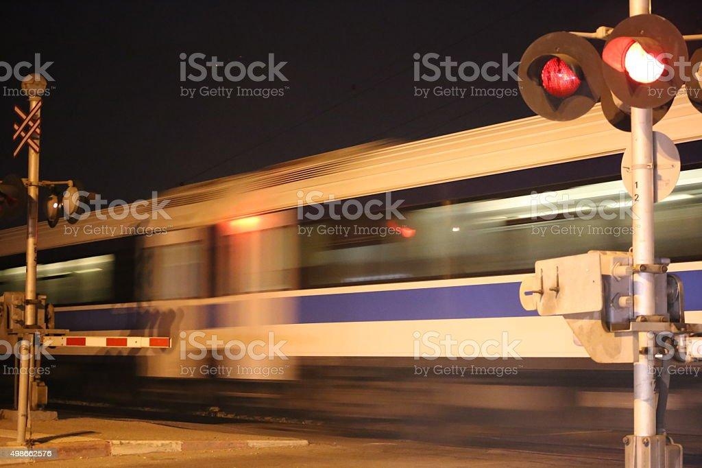 Train Passes Railroad Crossing stock photo