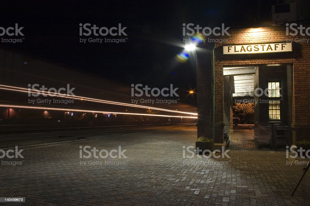 Train Passing Station at Night royalty-free stock photo