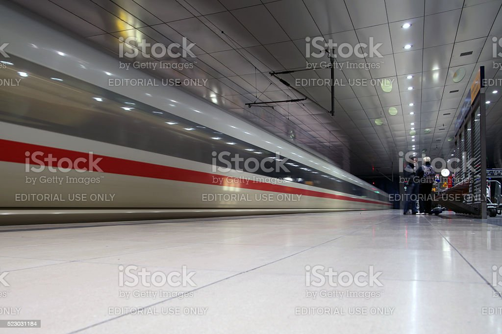 ICE train passing through station in Frankfurt stock photo