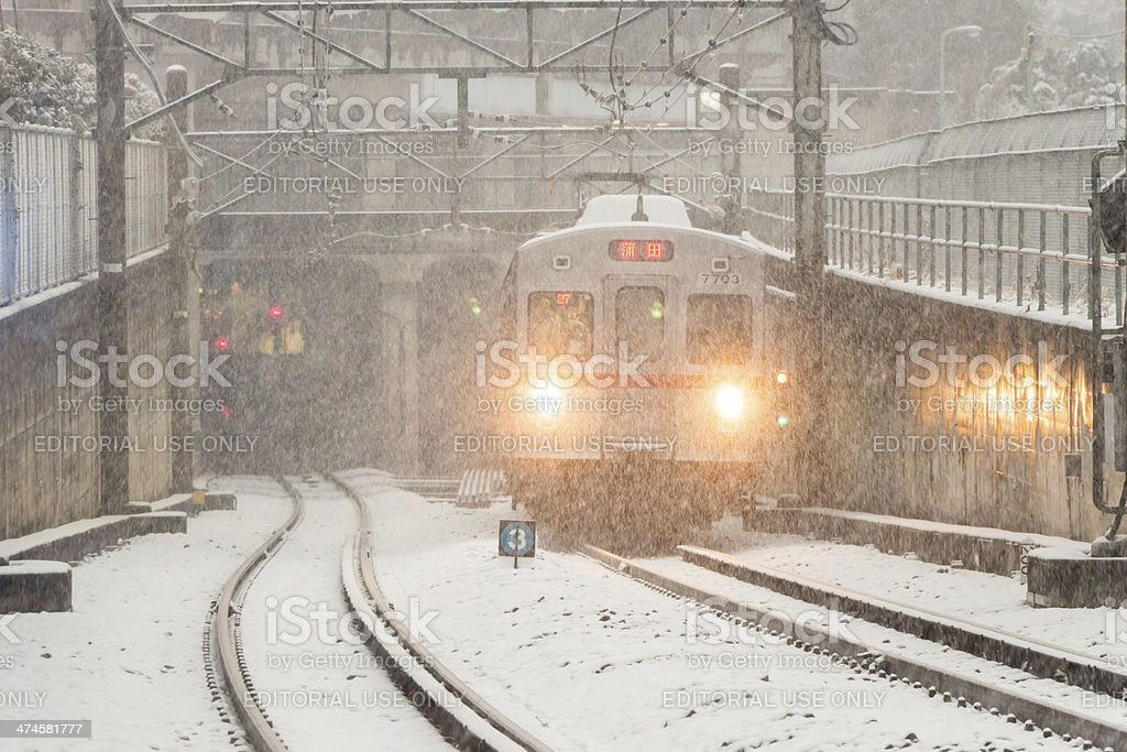 Train plowing through snow storm stock photo