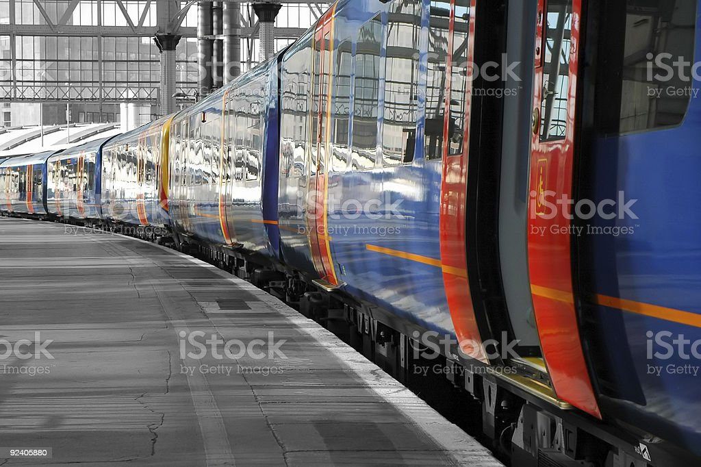 Train pulled up in station with open doors stock photo