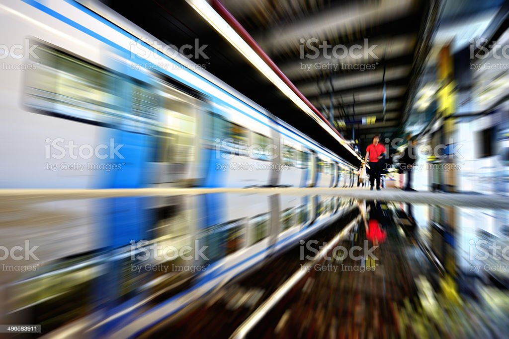 Train reflected in water puddle royalty-free stock photo