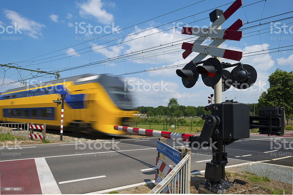 Train riding over a rail crossing in spring stock photo