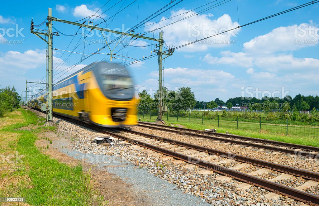 Train riding through the countryside in spring stock photo