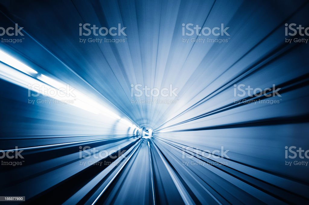 Train runnin fast on the tunnel - motion blur effects stock photo