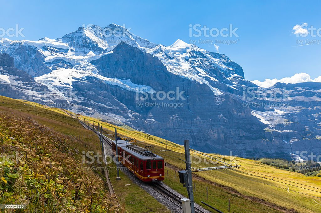 Train running under the Jungfrau stock photo