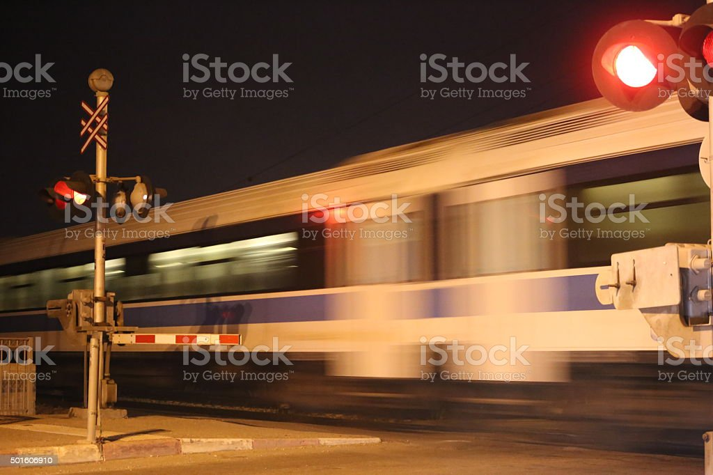 Train Speeding in Railway Crossing stock photo