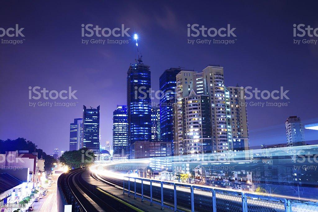train through city with blur trail stock photo