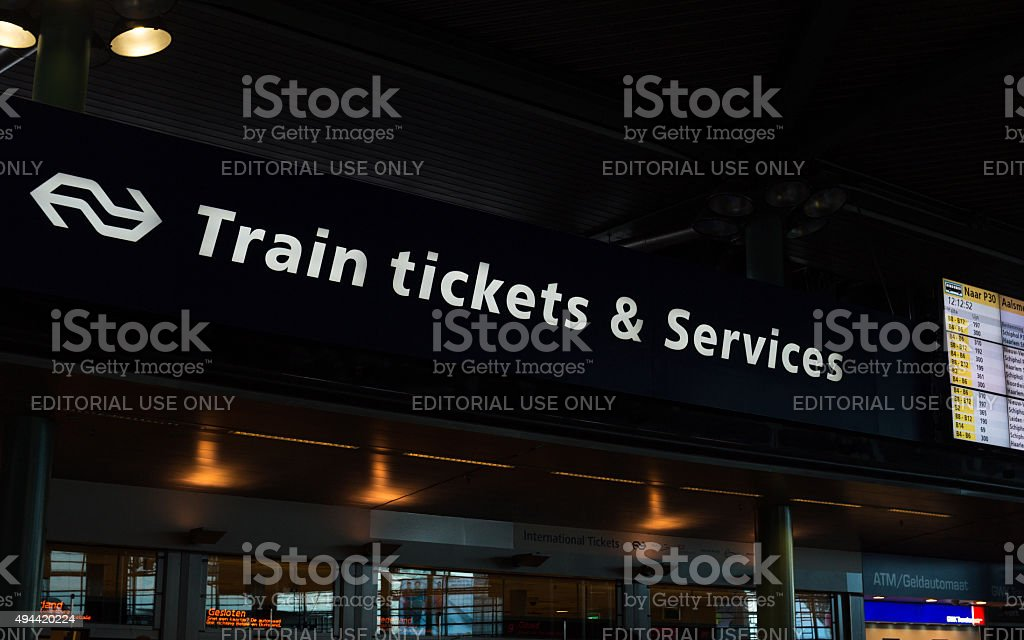 Train tickets and services in Amsterdam Schiphol Railway Sation stock photo