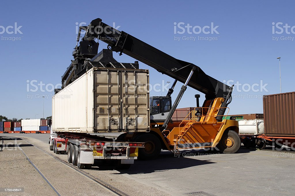 Train to truck freight container transfer stock photo