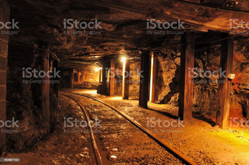 Train track in coal mine stock photo