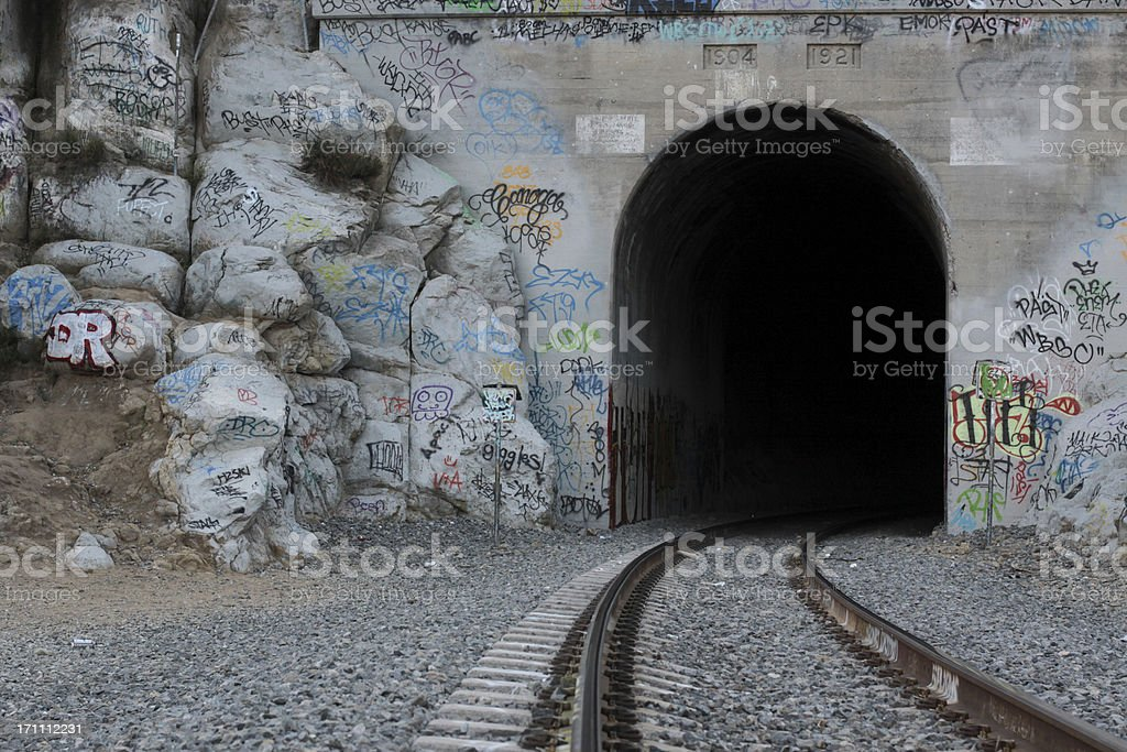 Train Track, Tunnel and Graffiti royalty-free stock photo