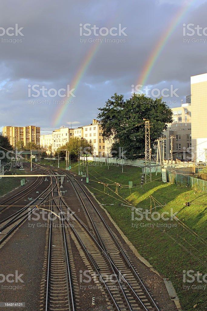 Train tracks and rainbow royalty-free stock photo