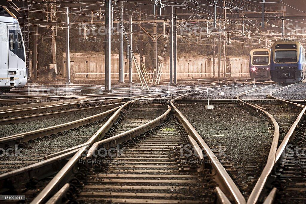 Train tracks at night stock photo