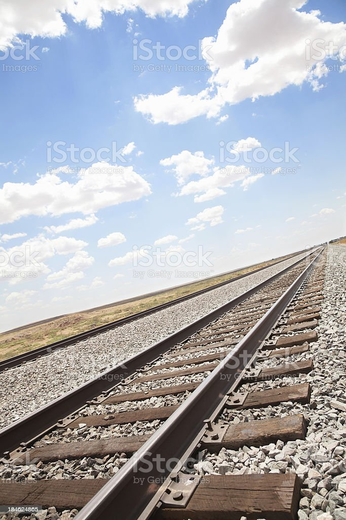 Train tracks heading out in the desert royalty-free stock photo