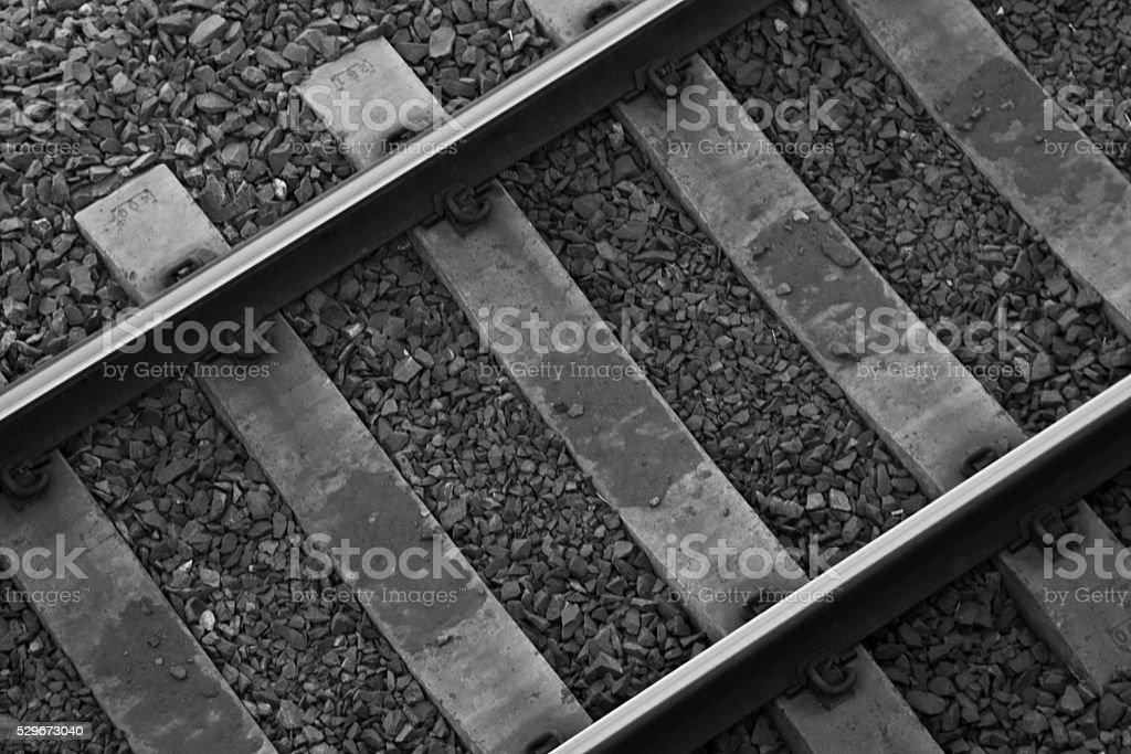 Train tracks in black and white stock photo