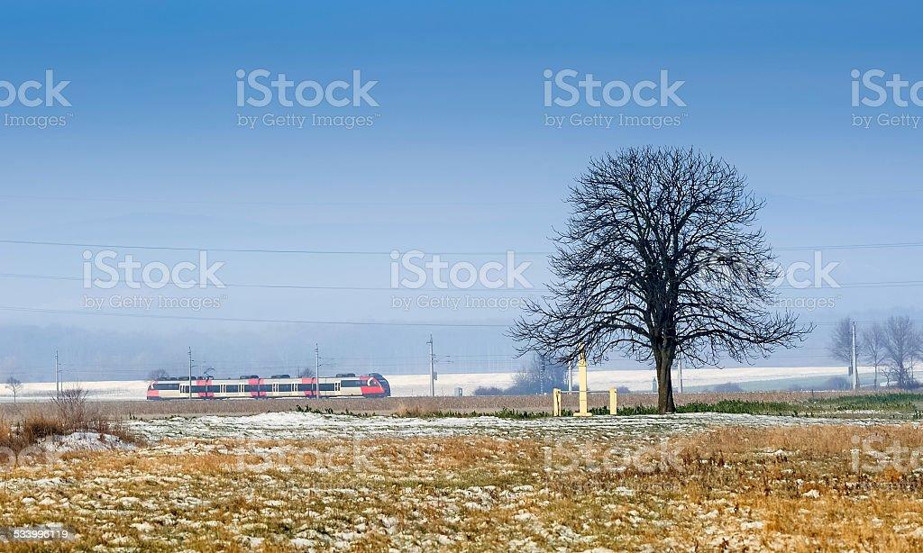 Train travels through flat countryside stock photo