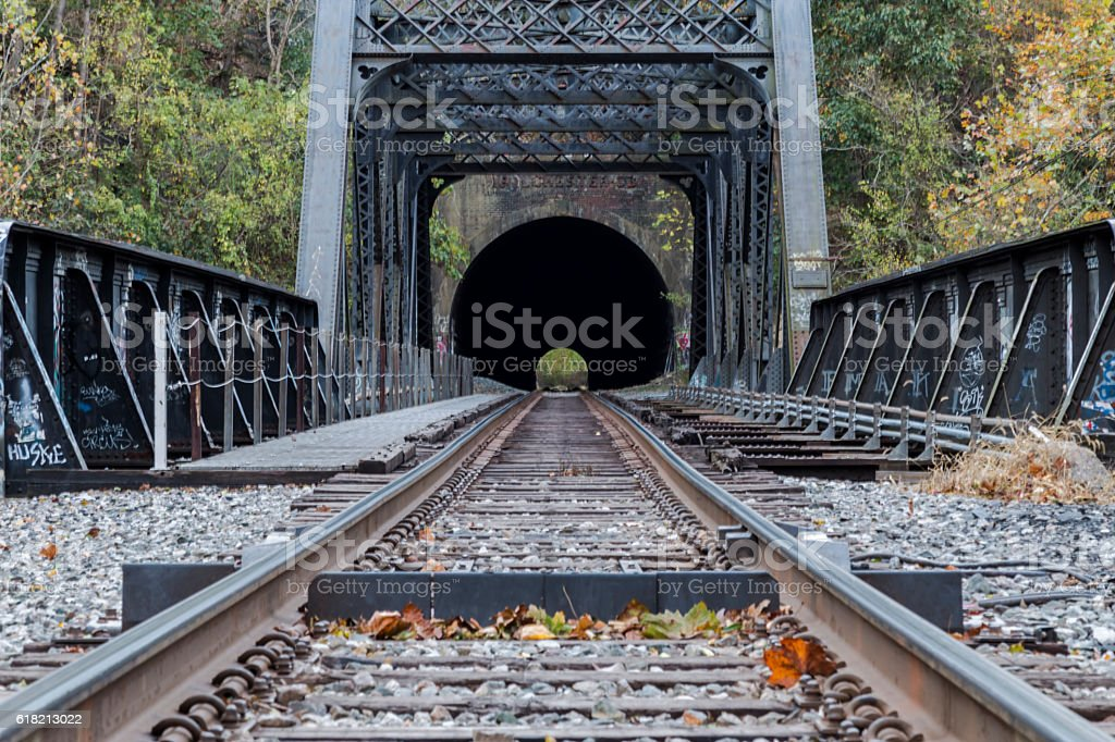 Train trestle leading to tunnel stock photo