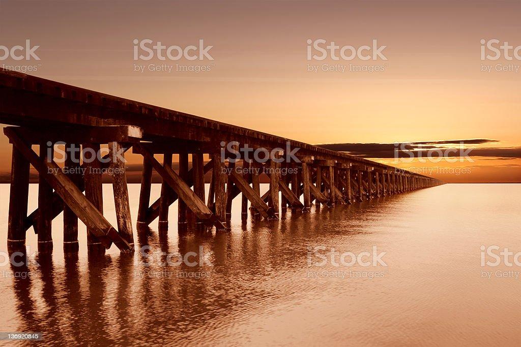 XL train trestle sunset royalty-free stock photo