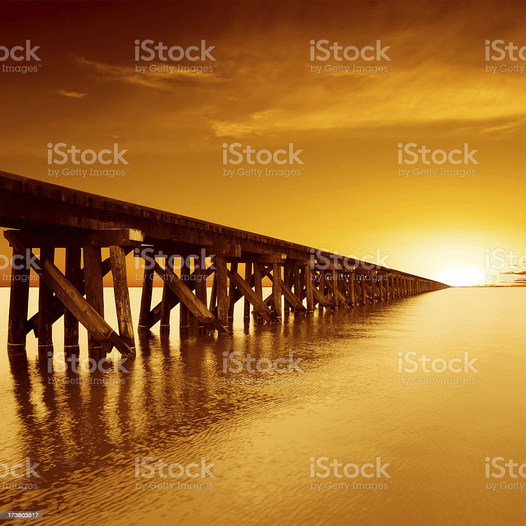 XL train trestle sunset stock photo