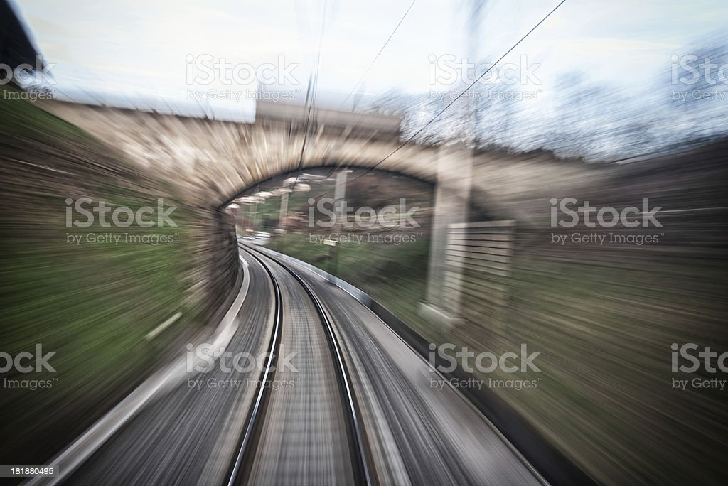 train under bridge stock photo