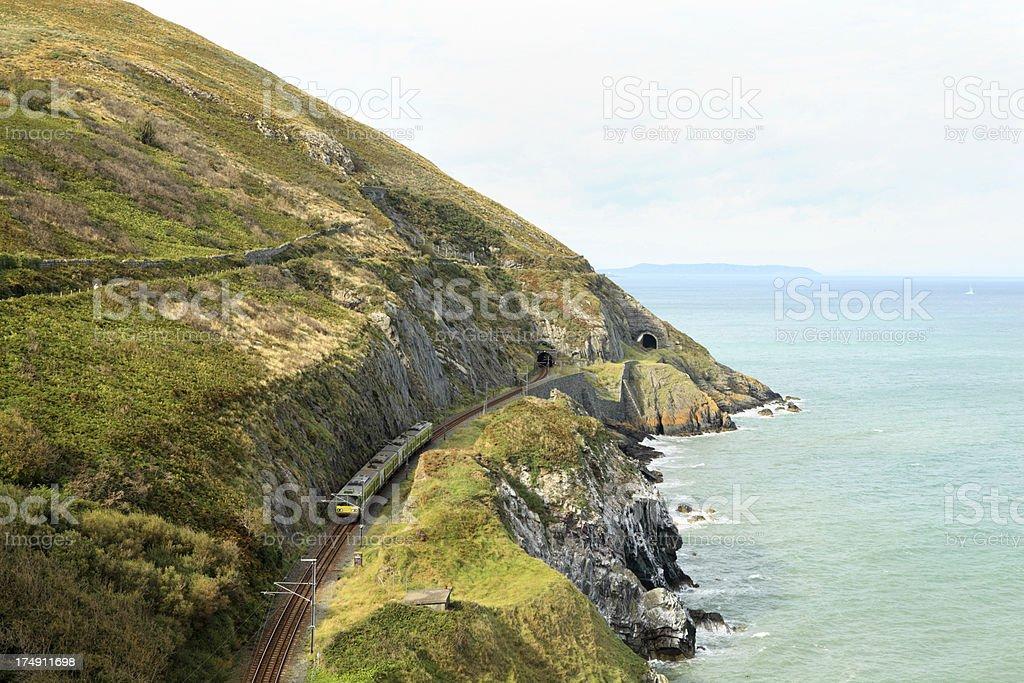 train using new track on coastal railway Wicklow Ireland stock photo