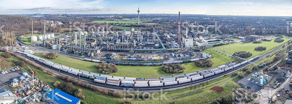 Train waiting in front of petrochemical plant stock photo