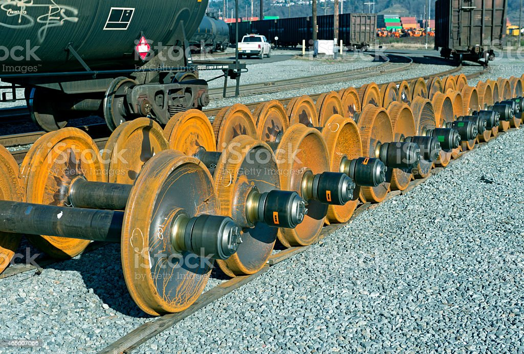 Train wheels near oil cars in industrial part of Tacoma stock photo