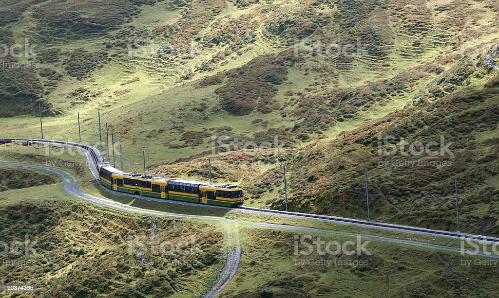 Train winding through the mountains royalty-free stock photo