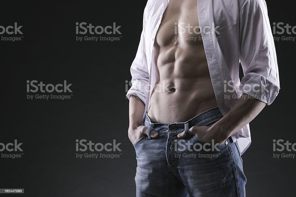 trained body wearing demim royalty-free stock photo