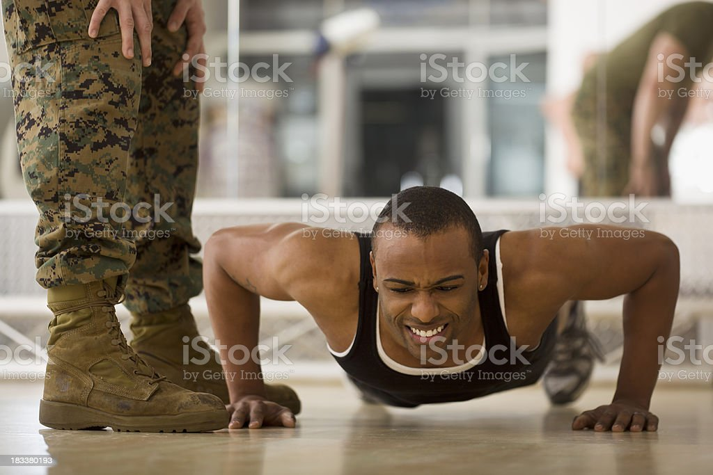 Trainee Doing Burpees at a Fitness Bootcamp stock photo