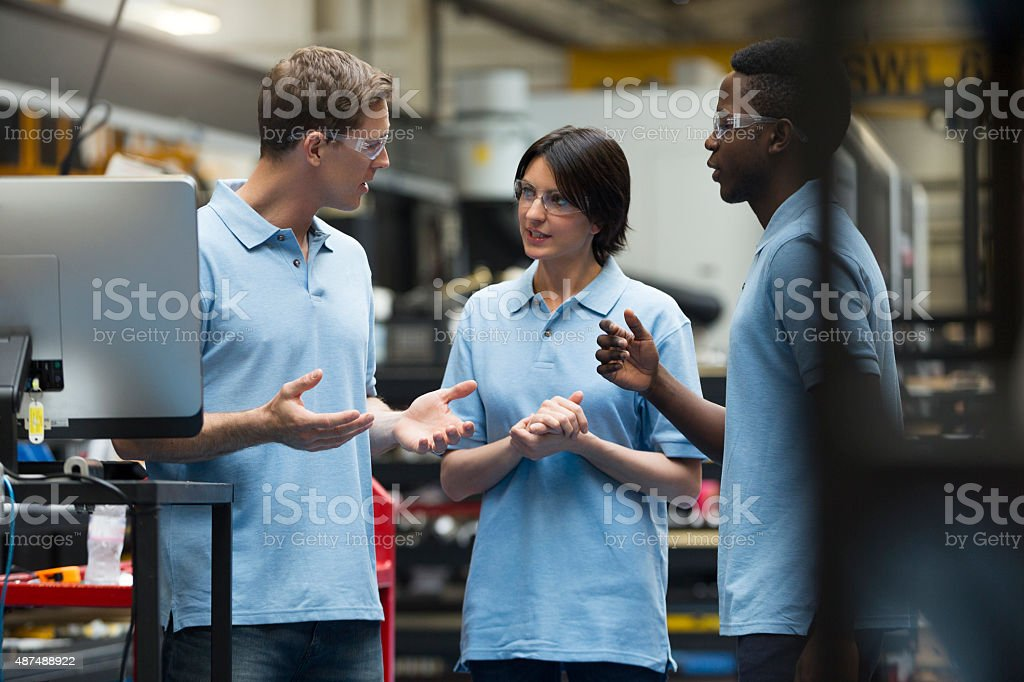 Trainee Workers in Factory stock photo