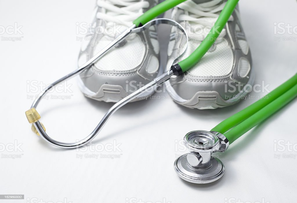 Trainer and stethoscope. royalty-free stock photo
