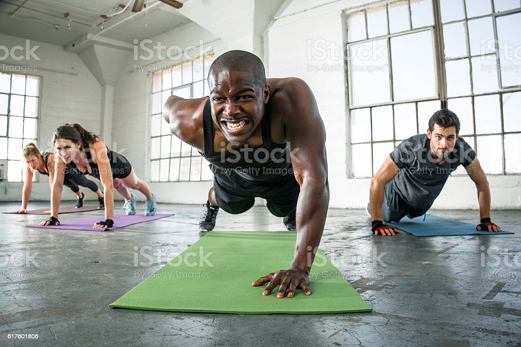 Trainer gym class group gym challenge gritting teeth drive stock photo