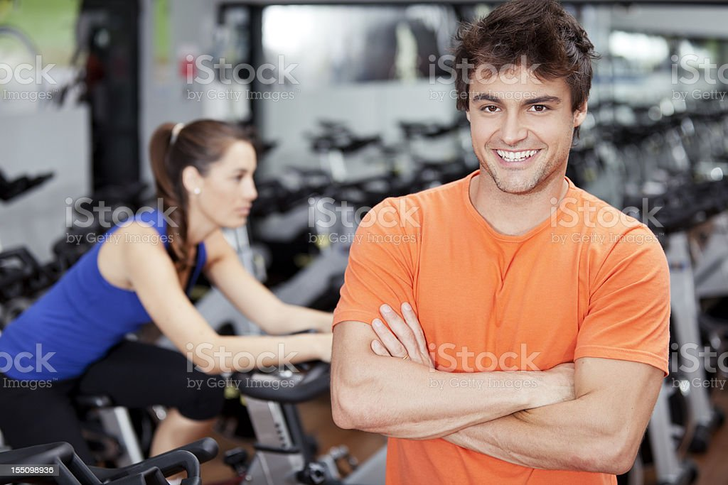Trainer in a cycling class royalty-free stock photo