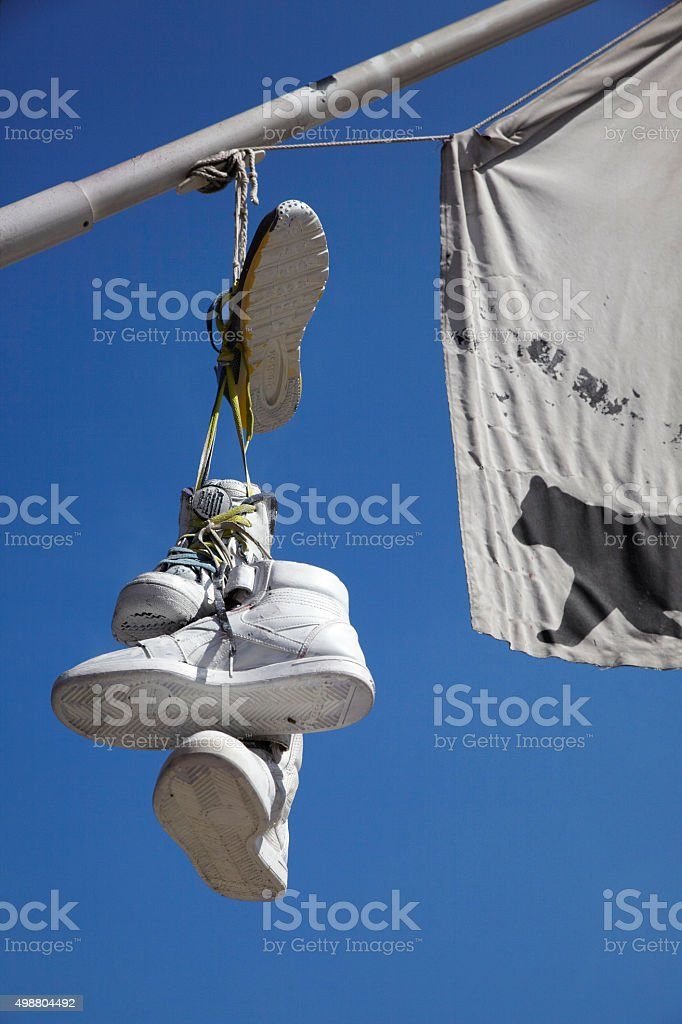 trainers hanging to mark turf stock photo