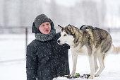 Training a siberian husky dog outdoors in winter