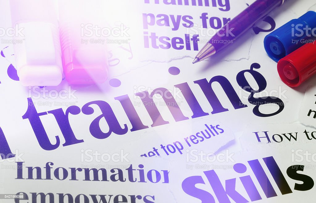 Training and skills headlines with pens in sunlight stock photo