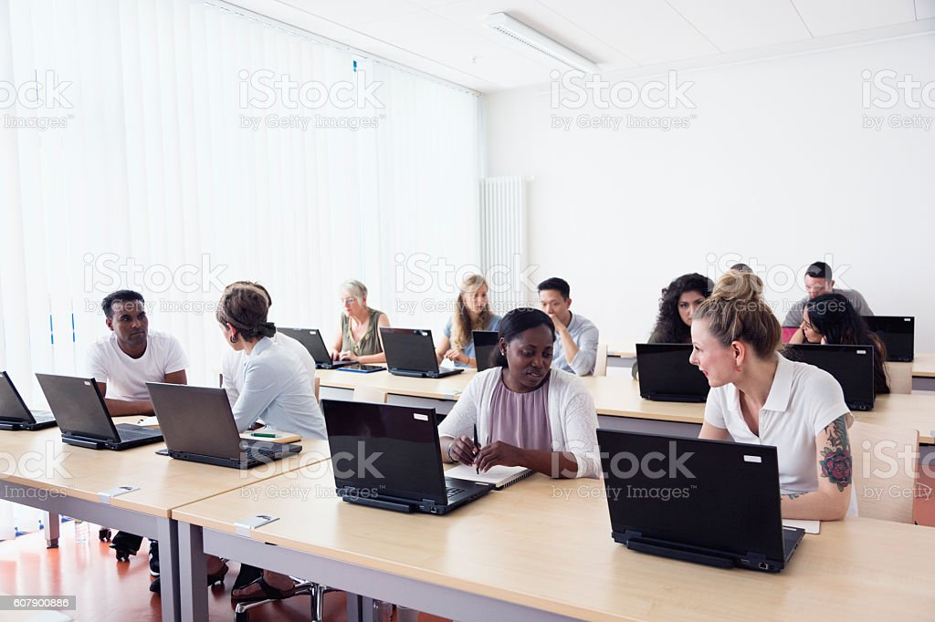 training class students learning at pc discussion stock photo