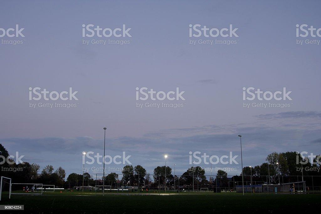 Training football at dusk stock photo