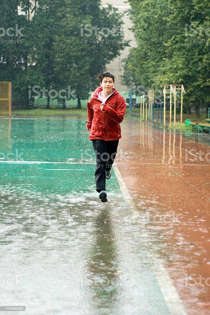 Training in the rain 2 stock photo