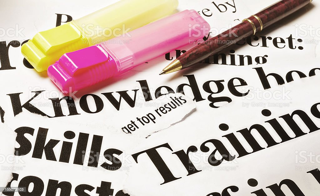 Training, knowledge, skills headlines with highlighters and pen royalty-free stock photo