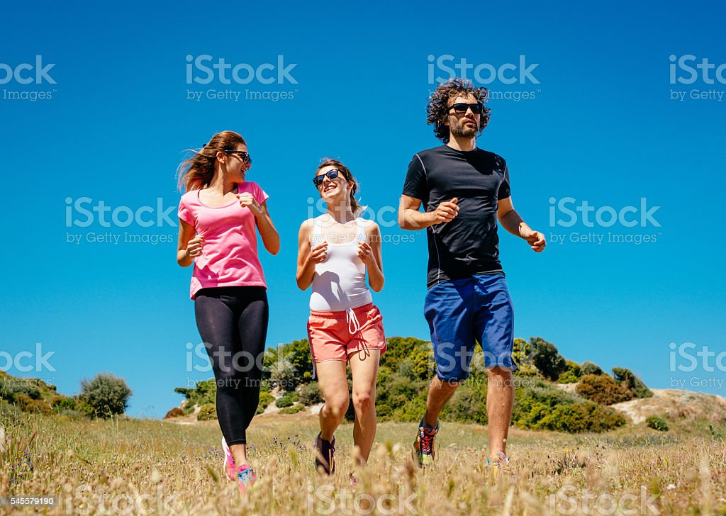 Training near the sea shore with friends and team mates stock photo