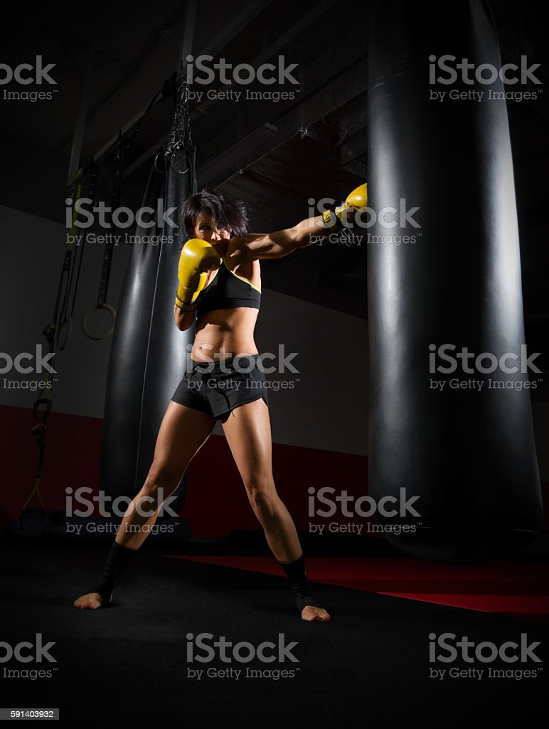 Training of kickboxer woman stock photo