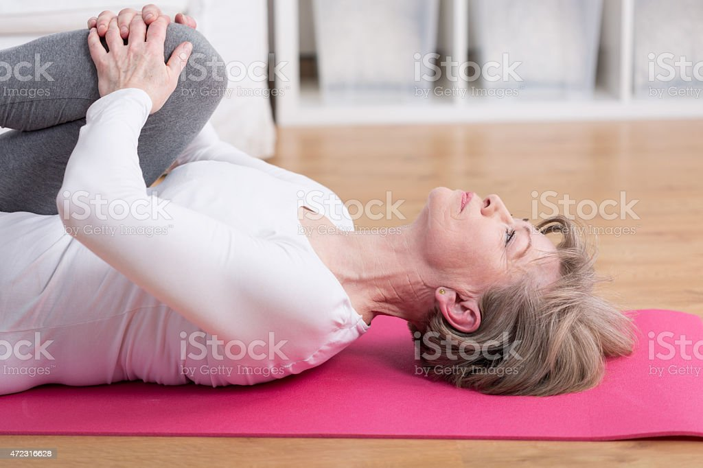 Training on the exercise floor mat stock photo