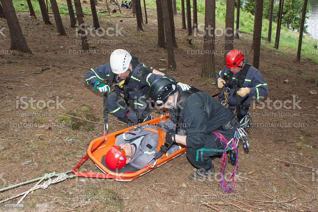 Training rescue injured people in difficult terrain stock photo